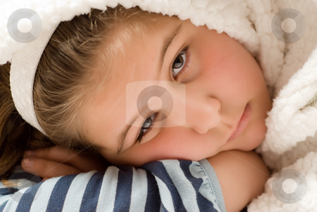 Naptime stock photo, Closeup view of a young girl lying down for a nap by Richard Nelson