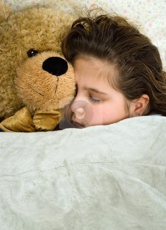 Sleeping stock photo, Young girl sleeping next to a stuffed animal by Richard Nelson