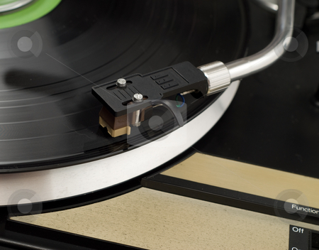 Record Player stock photo, Closeup of a record player, playing music by Richard Nelson