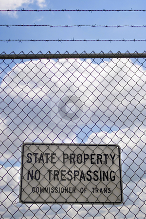 No Trespassing Sign stock photo, A no trespassing sign that reads STATE PROPERTY NO TRESPASSING outside an airport. by Todd Arena