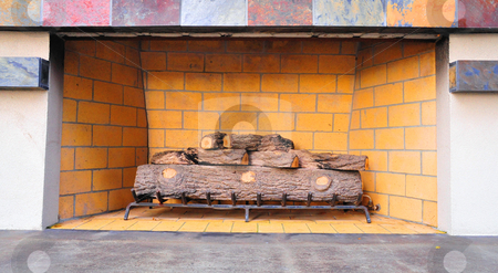 Outdoor Fireplace stock photo, Natural gas fired outdoor fireplace with ceramic logs on a steel grate by Lynn Bendickson