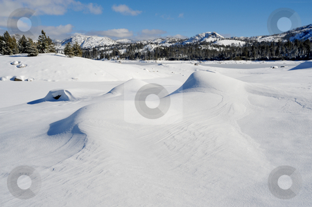 Windblown Snow stock photo, Fresh windblown snow covering the rocks and lake in the high sierra by Lynn Bendickson