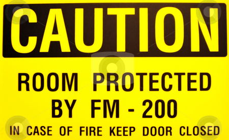 Yellow Caution Sign stock photo, Black and yellow caution sign warning to keep door closed in case of fire by Lynn Bendickson