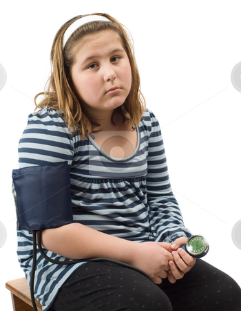Child Blood Pressure stock photo, A young girl sitting on a stool getting her blood pressure taken, isolated against a white background by Richard Nelson