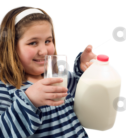 Child Milk stock photo, A young child holding a jug of milk along with a glass, isolated against a white background by Richard Nelson