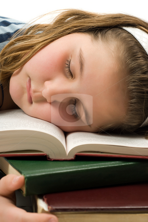 Fell Asleep Studying stock photo, Closeup of a young girl who fell asleep on her text books by Richard Nelson