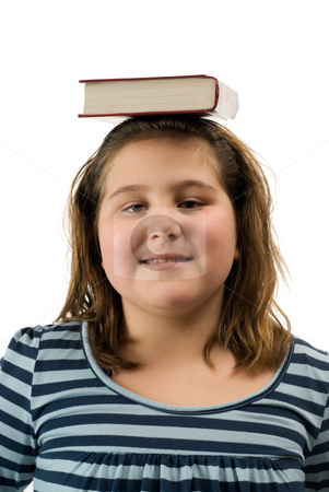 Good Student stock photo, A young girl balancing a text book on her head, isolated against a white background by Richard Nelson