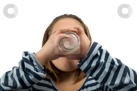 Drinking Milk stock photo, A child drinking a glass of milk, isolated against a white background by Richard Nelson