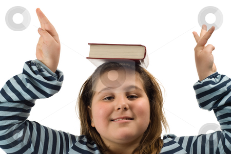Book On Head stock photo, Closeup of a child balancing a book on her head, isolated against a white background by Richard Nelson