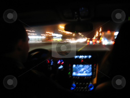 Night Driving Light Trails stock photo, Driving at night in a modern luxury vehicle. by Todd Arena
