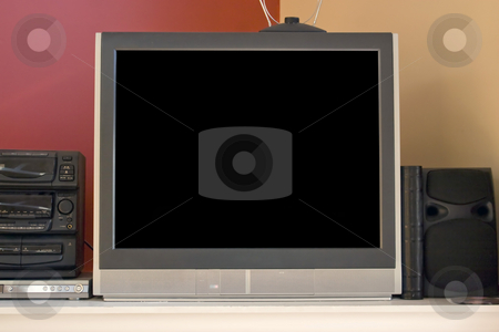 Home Entertainment stock photo, A modern picture tube tv set - 32 inch.  Standard aspect ratio, non-widescreen.  Also in the shot is a set top antenna, stereo, and dvd player.  Included clipping path for the screen. by Todd Arena