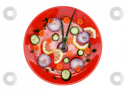 Red plate healthy clock stock photo, Red plate with cut vegetables isolated over white by Julija Sapic