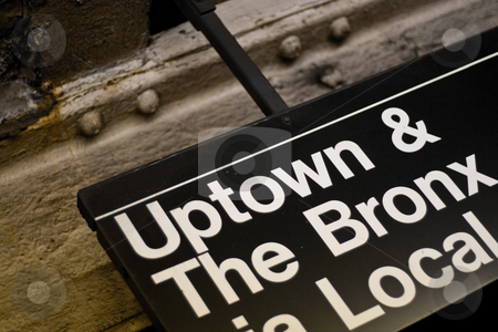 NYC Subway Sign stock photo, A New York City subway sign pointing to Uptown and The Bronx. by Todd Arena