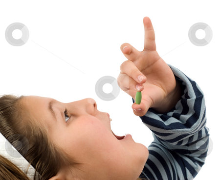 Child Taking Pill stock photo, Closeup view of a child taking a pill, isolated against a white background by Richard Nelson