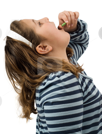 Take A Pill stock photo, Young girl about to swallow a pill, isolated against a white background by Richard Nelson
