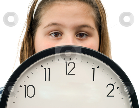 Time stock photo, Young girl shot behind a large wall clock, isolated against a white background by Richard Nelson