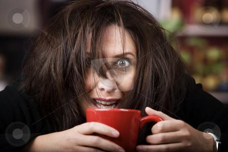 Coffee-Crazed Woman stock photo, Half awake woman cradling a mug of coffee by Scott Griessel
