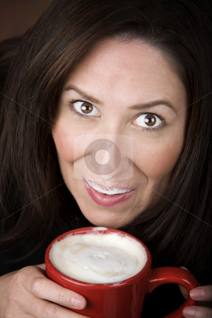 Woman with Coffee stock photo, Woman with foam from coffee specialty drink on her lip and nose by Scott Griessel