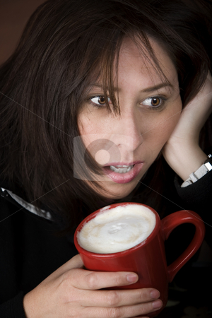 Woman in need of coffee stock photo, Half awake woman cradling a mug of coffee by Scott Griessel