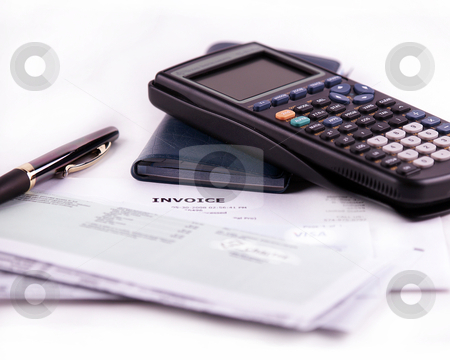 Paying bills concept stock photo, Concept shot of a calculator, pen,checkbook, and bills. on a white background. by W. Paul Thomas
