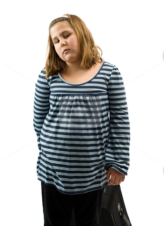 Child Going On Vacation stock photo, A young girl pulling her suitcase behind her, isolated against a white background by Richard Nelson