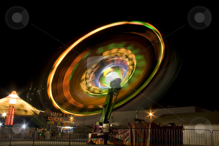 Night at the fair stock photo, Amusement park ride at the state fair. by Robert Ranson