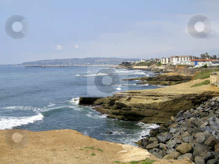 California rocky coastline stock photo, California rocky coastline with peir and housing way off in the distance. by Robert Ranson