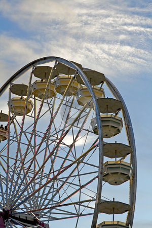 Ferris-wheel ride at the fair stock photo, Ferris wheel with light viewed at dawn during a state fair. by Robert Ranson
