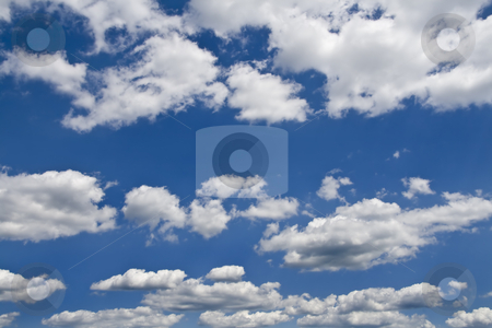 Clouds in blue sky stock photo, Beautiful clouds in the sky on a nice summer day. by Robert Ranson