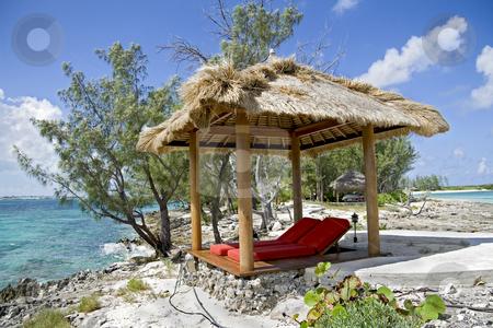 Beach hut on small tropical island stock photo, Beach hut on beautiful small and rocky tropical island. by Robert Ranson