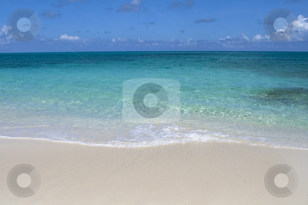 Beautiful tropical shoreline stock photo, Beautiful tropical shoreline with clear green water and wave rolling up on white sandy shore. by Robert Ranson