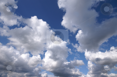 Fluffy clouds  stock photo, Nice white fluffy clouds with blue sky by Karin Claus