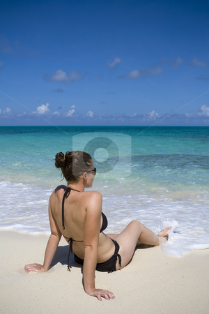 Relaxing in the tropics stock photo, Young female relaxing on a tropical beach. by Robert Ranson