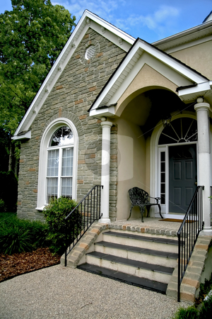 Modern House stock photo, Entrance door of modern stone house. by Robert Ranson