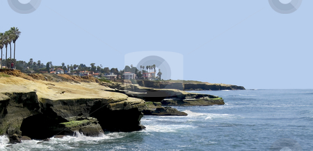 California Coast Line stock photo, California coastline with homes and hotels scattered about.  Palm Trees and waves crashing on rocks. by Robert Ranson