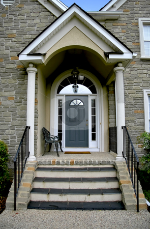 Modern house enterance stock photo, Enterance door to new modern stone house. by Robert Ranson