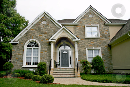 Modern house stock photo, New modern stone house front view. by Robert Ranson