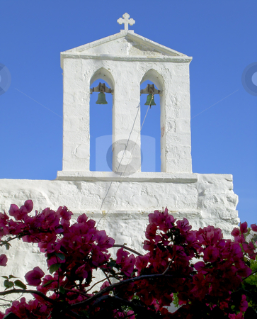 Old white church stock photo, Old white church on Kimolos Island with vivid blue sky in the background. by Robert Ranson