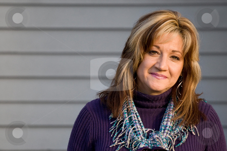 Smiling Woman stock photo, A pretty middle aged woman with a very sincere smile. by Todd Arena