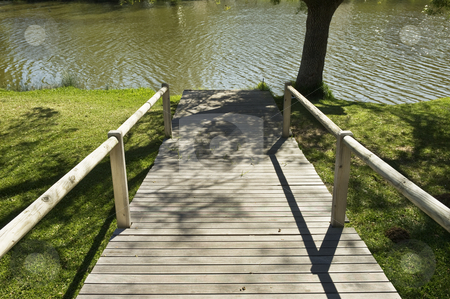 Wooden pathway in a natural park stock photo, Wooden pathway leading to the river in a natural park by Manuel Ribeiro