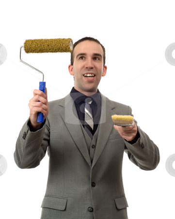 Businessman Painting Your Text stock photo, A young businessman painting your text, isolated against a white background by Richard Nelson