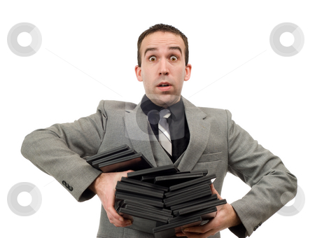 DVD Rentals stock photo, A man wearing a suit carrying an armful of dvd cases, isolated against a white background by Richard Nelson