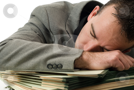 Sleeping Businessman stock photo, A young businessman who fell asleep on his paperwork by Richard Nelson