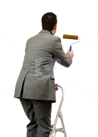 Man Painting Your Text stock photo, A young man wearing a suit is painting your text, isolated against a white background by Richard Nelson
