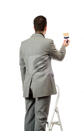 Businessman Painting A Sign stock photo, Behind view of a businessman painting something, isolated against a white background by Richard Nelson