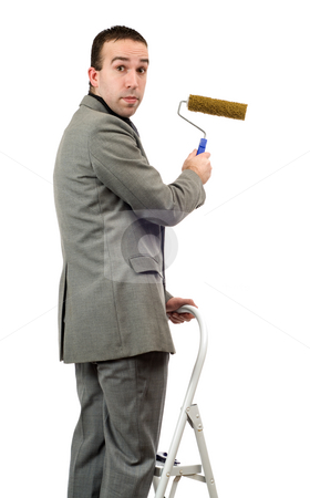 Businessman With Roller Brush stock photo, A young businessman painting a sign with a roller brush by Richard Nelson