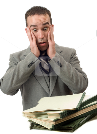 Too Much Work stock photo, A young businessman feeling overwhelmed at all the work he has to do, isolated against a white background by Richard Nelson