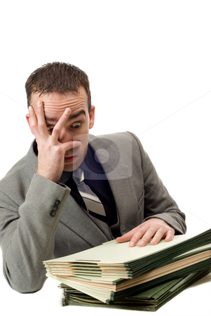 Overworked Businessman stock photo, An overworked businessman looking stressed, isolated against a white background by Richard Nelson