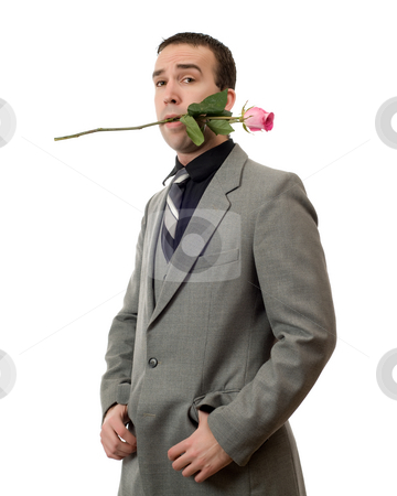 Valentine Man stock photo, A young man wearing a suit holding a single rose in his mouth, isolated against a white background by Richard Nelson