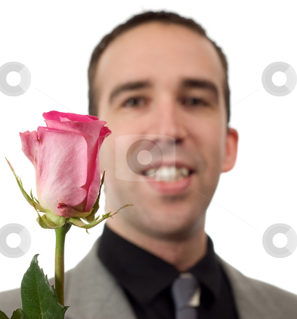 Romantic Man stock photo, Closeup view of a romantic man and a rose, isolated against a white background by Richard Nelson